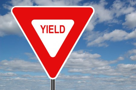 Yield sign w pleasant clouds